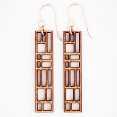 AWESOME AWESOME laser cut wood earrings. they kinda remind me of bookcases.