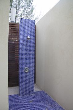 Bathroom - An outdoor shower with bright blue tile