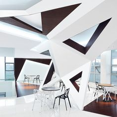 Arthouse Café designed by Joey Ho Design. These walls are very dramatic and I love the geometric shapes that connect the ceiling, walls and floor.