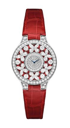 Graff Ruby Butterfly Watch in white gold, set with 335 diamonds, 78 rubies and 22 diamonds on the buckle, and fastened with a red crocodile strap.