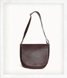 I have this bag in dark magenta. Love it.