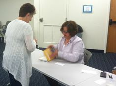 Gail Goodman signing a copy of Engagement Marketing for a Constant Contact employee!