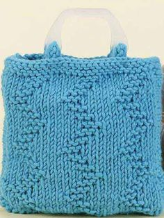 """This handy knitted bag is enhanced with a rugged texture pattern and purchased handles. Bag size: 11"""" x 10"""" x 2"""", size 13 needles, wool/acrylic bulky weight yarn. Skill Level: Easy"""