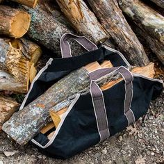 Heavy Weight Canvas Log Tote - Black.  This Heavy Weight Canvas Log Tote will save you time and energy when it comes to hauling your firewood in this season. It's made of durable canvas material with reinforced seams for added strength. #woodtote #tote #logtote #firewood