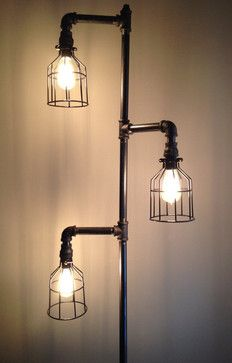 Down the Pipeline - Industrial Plumbing Pipe Floor Lamp.  Lamp has 3 adjustable arms to fit any decoration/room style. Light assembly may be required to reduce cost of shipping.  Comes with 3 vintage light bulb (style of bulb may differ from pictured) and 3 wire light cages.
