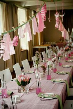 I think the hanging outfits is cute, one pin had them hanging a long a table. I have clothes pins and we could use twine, that would go well with burlap.