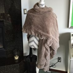 Super soft grey faux fur poncho/wrap Super soft, wears several ways grey faux fur wrap. Brand new in package. Jackets & Coats