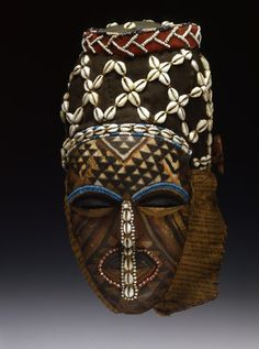 Africa | Female dance mask from the Kuba people of Congo | Wood, textiles, cowrie shells, glass beads | 19th century | The mask represents Ngady Mwaash, the sister (more rarely the mother) of the mighty Woot, the founder of the kingdom