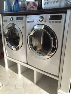 Contemporary Washer And Dryer Pedestal Cabinet With Cubbies Below To Sort Dirty Laundry