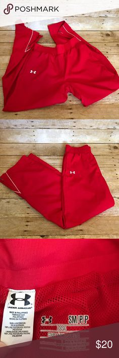 Men's Under Armour track pants Men's size small- Under Armour Loose All Season track athletic gear pants in bright red. Zippers at both ankles. Excellent condition, like new! Comes from smoke free home. I ship next business day after payment is received. Please check out my other items :) Under Armour Pants Sweatpants & Joggers
