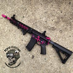 My next gun will be an AR-15. In love with this custom AR!! I am not a fan of all pink guns, they look so silly to me. But this is a nice combo of pink n black  <3 tuck is getting me one for my bday I'll hafta reference this ;)
