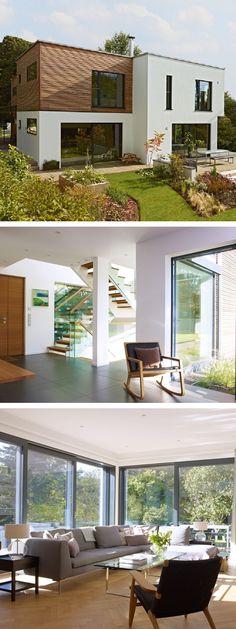 Bauhaus Stadtvilla Design modern mit Flachdach Architektur & Garage - Einfamilienhaus bauen Fertighaus Crichton von Baufritz - HausbauDirekt.de