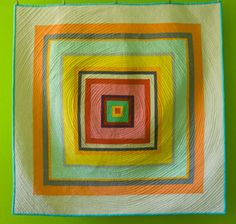 This Baby Log Cabin Quilt Pattern is colorful and modern.