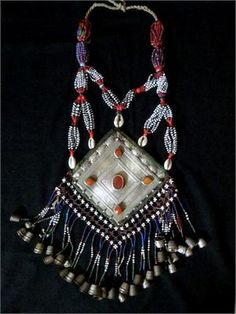 Old Turkmen Tribal Jewelry - Large Silver Gonjik Necklace. |  Handcrafted (approx 100 years ago) in Silver, Carnelian, Cowrie Shells, Thimbles and beads. The gonjik refers to the name for the large central pendant.