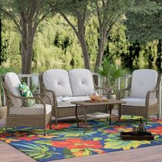Lark Manor Carly 4 Piece Rattan Sofa Seating Group with Cushions Cushion Colour: Beige Patio Furniture Covers, Outdoor Furniture Sets, Wicker Furniture, Garden Furniture, Antique Furniture, Furniture Design, Outdoor Seating, Outdoor Decor, Outdoor Living