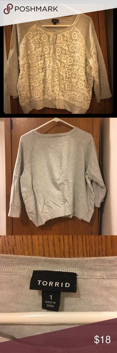 > Torrid < Gray & White-Lace Cropped Cardigan Torrid Size 1. A cool-weather essential! Throw on this cute cardigan over your tops and dresses for an added layer. Lightweight, 3/4-length sleeves, six button closures. No damage, machine-washable. Smoke-free home. torrid Sweaters Cardigans