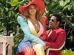 Beyonce flashes as she sits on Jay-Z's lap during photo shoot in Jamaica  The chart-topper, 36, sat on her husband's lap as they took part in a photo shoot, just steps away from the beach. The couple were working in Thursday in Kingston, Jamaica.  http://www.dailymail.co.uk/tvshowbiz/article-5539769/Beyonce-flashes-sits-Jay-Zs-lap-photo-shoot-Jamaica.html?ITO=1490&ns_mchannel=rss&ns_campaign=1490