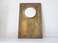 Vintage mirror with lion detailing wood by MidModandMorganstern, $95.00