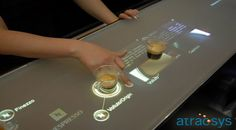 Multi touch screen interactive coffee table designs to suit the modern needs of restaurants and cafes. Table Interactive, Interactive Touch Screen, Interactive Media, Interactive Installation, Interactive Design, Multimedia, Digital Retail, Touch Screen Technology, Future Gadgets