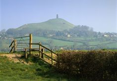 Glastonbury Tor Glastonbury Tor is a hill at Glastonbury in the English county of Somerset, topped by the roofless St Michael's Tower, a Grade I listed building. The whole site is managed by the National Trust, and has been designated a scheduled monument. Wikipedia