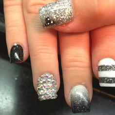 Black sparkle, rhinestone encrusting, sparkling black/white ombre, white/ sparkly graphite stripes, and silver sparkly nail.