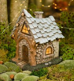 Miniature Fairy Garden Solar Fireside Cabin   Miniature Fairy Gardens   Our Solar Fireside Fairy Cabin is a miniature fairy gardener's dream! Full of rustic charm, this resin house features faux stone siding, a shingled roof and arched doorway all hand-painted in exacting detail.
