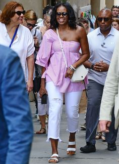 The former First Lady wore pink and white to tour the Italian city.