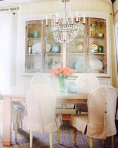 New cottage style, love monogrammed chairs and the chandelier