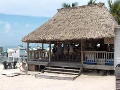 The popular BC's Beach Bar on Ambergris Caye in the town of San Pedro is the place to be on this tiny island off the coast of Belize. Ambergris Caye, Bar Plans, Beach Bars, Beach Signs, Beach Club, Restaurant Design, Belize, Architecture, House Styles