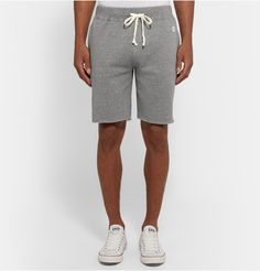 Todd Snyder + Champion's grey mélange shorts are supremely versatile. Ideal for working out at the gym or lounging on the weekend, they're cut from breathable loopback cotton-jersey that will keep you comfortable wherever you go. Shown here with a Todd Snyder + Champion T-shirt, Converse sneakers and J.Crew messenger.