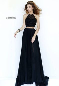 """Pretty! sherri's blurb: """"Elegant two piece shimmers with black beading on the crop top with halter neckline and low back. Sheer pleated full length skirt exposes a surprise high slit on the lining."""" #black #prom #promdress #sherrihill #longpromdress  #wedding #weddingdress style #32109"""