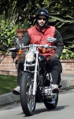 Keanu- has he learned how to defy gravity for real?!  His feet are up but the bike seems still!