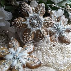 Snowflakes in blue ~ Gingerbread keepsake snowflakes Christmas gingerbread cookies, intricately hand piped and dry brushed with luster dust.