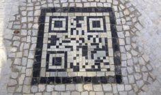 "Rio de Janeiro installs QR codes to ""help"" visitors navigate city sidewalks"