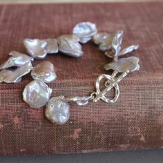 This pearl bracelet is just like petals around your wrist.