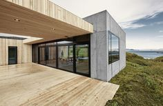 Photo 3 of 13 in A Timber-and-Concrete Summer House in Iceland Boasts Breathtaking Views - Dwell Concrete Siding, Concrete Wood, Wood Siding, Concrete Architecture, Architecture Design, Building Design, Building A House, Interior Wood Shutters, Concrete Structure