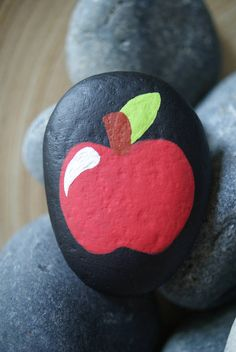 A painted stone to leave resting on a table, congratulate someone on becoming an educator or to bring a smile to your childs favorite teacher! Great for end of the year gifts! M E A S U R E M E N T S ~ Vary due to variety of natural rocks I use, measurements are an approximation. On top of a stone is a painted apple. Depending on which apple rock, a small, cute message or a teachers name can be written by yours truly. A name can be written on the back of any of the apple rocks. Also when…