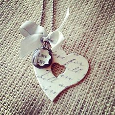 Heart with Love Life Charm Necklace. $40.00, via Etsy.
