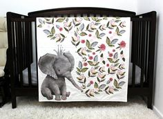 This listing is for one made to order quilt exactly as shown--give the most cherished gift with this sweet elephant baby quilt that will be loved for years to come! ..... This gorgeous baby quilt (dimensions: 34x40) features the cutest elephant wearing a crown and blowing flowers about in a
