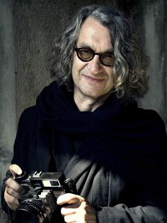 Wim Wenders (film maker turns photographer) here with a Plaubel Makina 67. AL