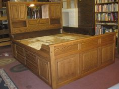 UHURU FURNITURE & COLLECTIBLES: SOLD - Oak King Captain's Bed - $200