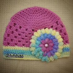 Beanie with popcorn rose..