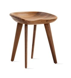Craig Bassam was working on a project in Switzerland when he found a tractor seat on the side of the road. He was impressed by how the seat allowed him to sit in an upright, ergonomic position without the aid of a chair back, but unlike the metal seat that he found, he wanted to create this type of seat in wood. Bassam's Tractor Stool (2000/2001) is carved out of a massive block of sustainably and locally harvested walnut or ash, the quality of which is in the top 10% of top-grade woods.