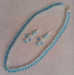 Silver seed with turquoise drop