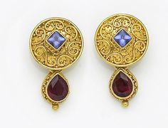 A pair of pink tourmaline, tanzanite and eighteen karat gold earrings, Alix
