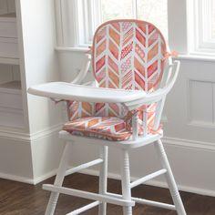 Kids Rocking Chair Pad in Coral Watercolor Herringbone by Carousel Designs.