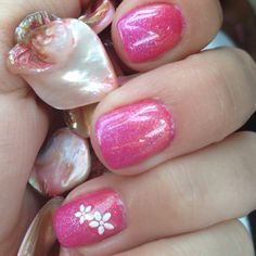 Shellac! I have this color on my nails right now. Not with the flowers though :)