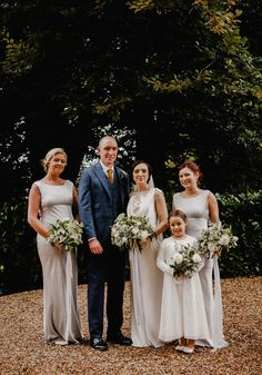 Bridesmaids wear silver dresses from Ghost. Photography by Noel Deasington.
