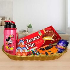 This joyful Kids Gift Basket contains Kinder pc, pc, Hot Wheels Car- 1 pc, Rubicube, Mickey Water Bottle Cadbury Licable- 3 pc. 1 Basket (The image displayed is in Baby Gift Hampers, Kids Gift Baskets, Johnson Baby Bath, Holi Gift, Dairy Milk Silk, Barbeque Nation, Brown Cushion Covers, Choco Pie, Chocolate Gift Boxes