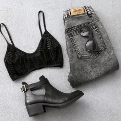 acid wash denim with black bralette and ankle books - nail the grunge look with these key pieces.
